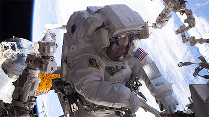 NASA astronaut Peggy Whitson at work during her spacewalk